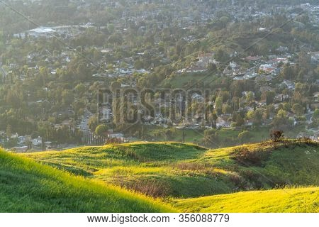 Early spring morning mountain view of homes and streets in the San Fernando Valley area of north Los Angeles, California.