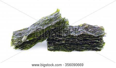 Crispy Nori Seaweed Isolated On White Background. Japanese Food Nori. Dry Seaweed Sheets.