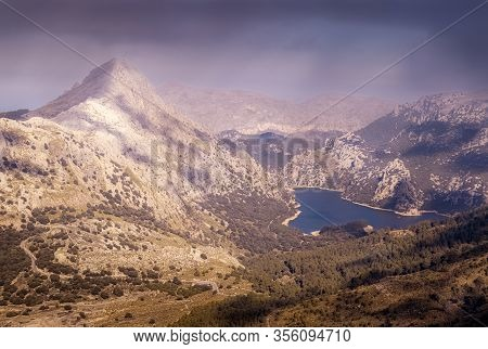 Gorg Blau And Tramuntana Mountains, Sun And Blue Skies With Low Clouds, Tramuntana, Mallorca, Spain.