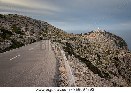 Cap De Formentor Lighthouse With Winding Road And Rocks, Near Pollenca And Alcudia, Mallorca, Spain.