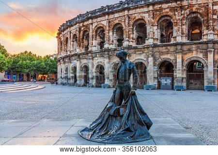 Nimes, France - July  2, 2018: Ancient Roman Amphitheatre In The Occitanie Region Of Southern France