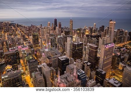Chicago, Illinois, Usa - October, 2019; Aerial View Of Chicago City At Sunset Lights. Chicago Skylin