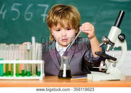 Biology Science. Little Boy Is Making Science Experiments. Little Boy At Lesson. Back To School. Sch