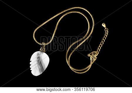Elegant Gold Necklace With White Nacre Pendant Isolated Over Black