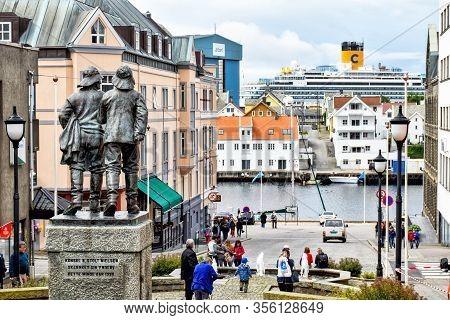 Haugesund, Norway - July 18, 2017: Downtown Of Haugesund In Norway. In The Foreground There Is A Sta