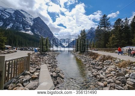 Lake Louise - May 20 2019: Lake Louise, Alberta, Canada Mount Fairview, Partly Frozen Lake, Al Lot O
