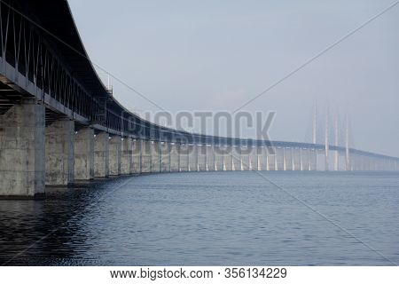 A Low Perspective Of The Oresund Bridge Stretching Out To The Sea And The Fog