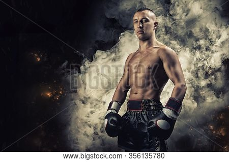 Portrait Of A Boxer Of Mixed Martial Arts. The Concept Of Sports, Mma, Kickboxing. Mixed Media