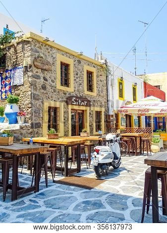 Kos, Greece - July 31, 2015: Taverns With Outdoor Seating In The Old Town Of Kos Town, The Capital O