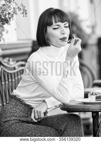 Delicious Gourmet Cake. Woman Attractive Brunette Eat Gourmet Cake Cafe Terrace Background. Gastrono