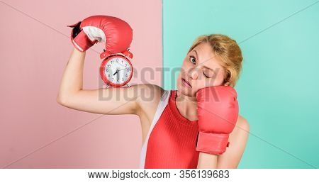 Control Time. Time Management Skills. Battle For Self Discipline. Woman Holding Clock Boxing Gloves.
