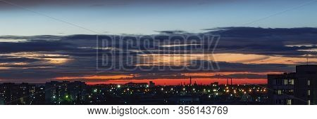 Sun Rising Above The City, Roof Top View Of An Old Church Tower. Summer Sunrise Or Sunset. Blue, Red