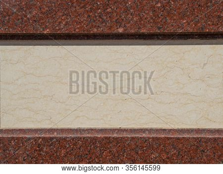 Two Granite Strips Of Red Color Above And Below, And In The Middle A Strip Of Marble The Color Of Ba