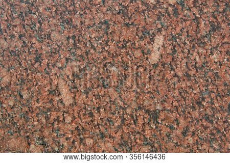 The Texture Of The Red Slice Of Granite With Small Black, Pink And Transparent Blotches. Mica, Spar