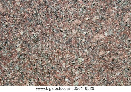 The Texture Of The Pale Pink Slice Of Granite With Small Black, White And Transparent Blotches. Mica