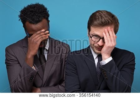 What To Do Now Concept. Two Stressed Businessmen Making Facepalm Gesture