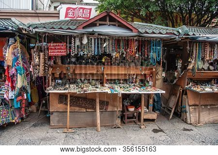Guilin, China - May 10, 2010: Downtown. Street Market With Semi-permanent Booths With Green Roofs Se