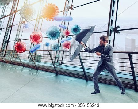 Businessman With Umbrella Covers Himself From Bacteria. Concept Of Solution To Stop Viruses Contamin