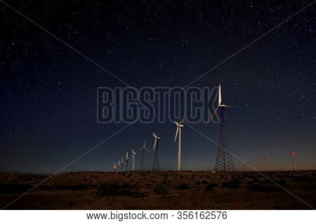 Camping at Night Under the Stars and Milky Way Windmills