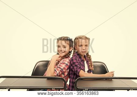 Little Girls School Friends Study Together. Students Classmates Sit Desk. Back To School. Private Sc