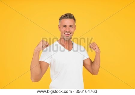 Strength And Power. Happy Bachelor Show Strength. Strong Man Flex Arms Yellow Background. Strength A