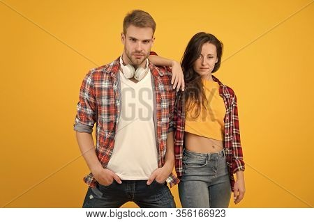 More Then Just Boyfriend And Girlfriend. Couple In Love Yellow Background. Handsome Man And Sexy Wom
