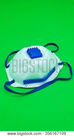 Medical Mask, Prevention Of Influenza. Protective Mask For Health Care Use On Green Background. Medi