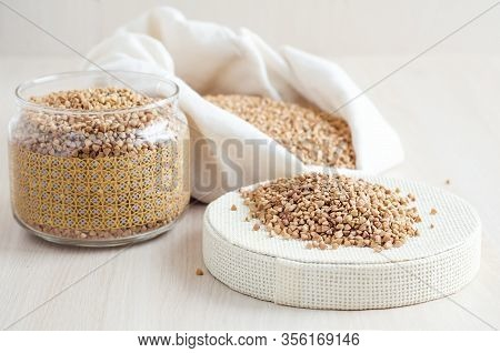 Emergency Ration Of Cereals, Buckwheat Porridge In Bag, Glass Jar On White Wooden Background, Copy S