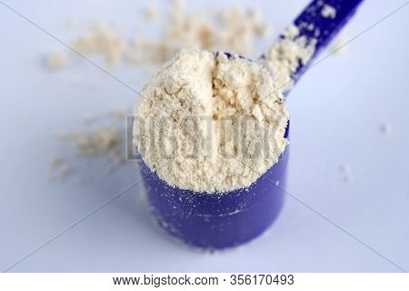 Portion Of Whey Protein Powder Top View. A Full Scoop Of Whey Protein. Top Quality Sports Nutrition