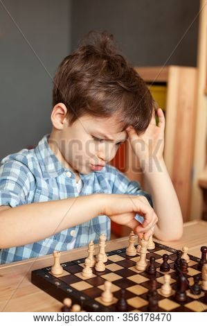 Child Plays Chess, Boy In A Plaid Shirt