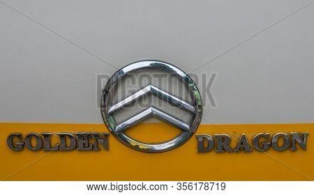 Guilin, China - May 10, 2010: Downtown. Closeup Of Shiny Metalic Nanjing Golden Dragon Bus Building