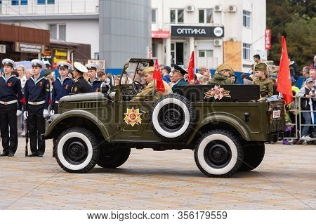 Anapa, Russia - May 9, 2019: A Car With Veterans And Children Awaits The Start Of The Victory Parade