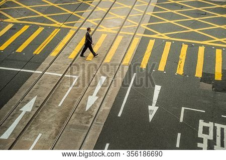 Hong-kong - 7 April 2015: Man Alone Walking On Zebra Crossing, Illustration Of Social Distancing