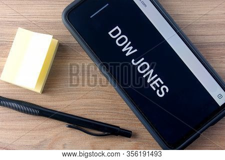 Rio De Janeiro, Brazil - March 16, 2020: Dow Jones Logo Is Displayed On A Smartphone. It Is A Stock