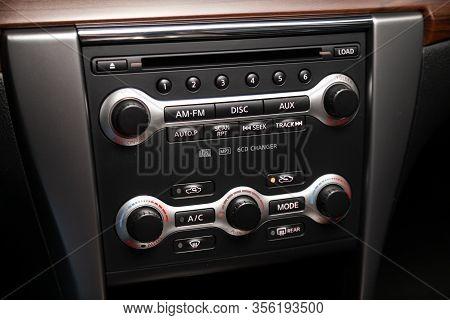 Novosibirsk, Russia - March 07, 2020: Nissan Teana,  Modern Black Car Interior: Climat Control View