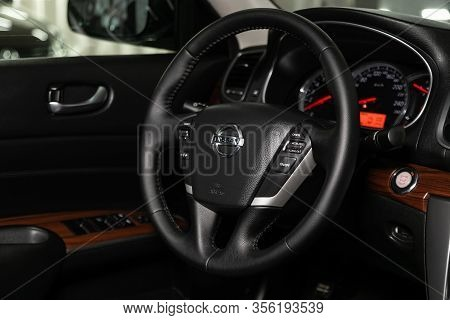 Novosibirsk, Russia - March 07, 2020: Nissan Teana,  Dashboard, Player, Steering Wheel With Logo And