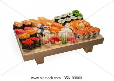 Guncan with eel, Fresh Avocado Sushi, Ikura, Ebi, Uramaki Sushi Roll, Rice Paper Rolls on wooden board isolated on white background
