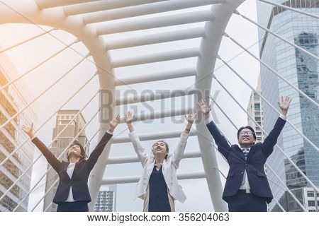 Teamwork Together Concept. Group Of Diversity People High Five On Air To Greeting Power Of Tag Team.