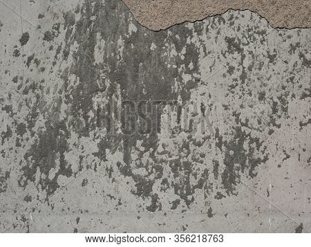 Dirty Concrete Wall With Fallen Plaster, Wall With The Cement Spatter