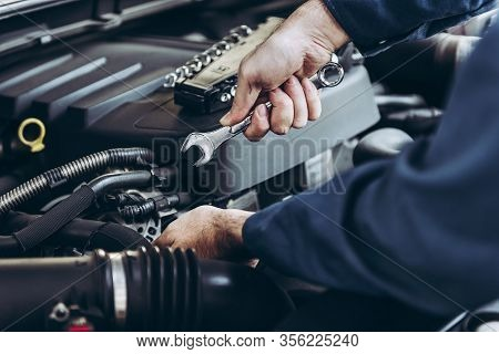 Mechanic Car Service Man Is Working In Garage Workshop, Technician Automotive Is Inspection Checking