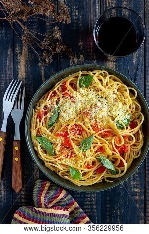 Pasta Spaghetti With Tomatoes, Basil And Parmesan Cheese. Italian Cuisine. Recipe. Vegetarian Food.