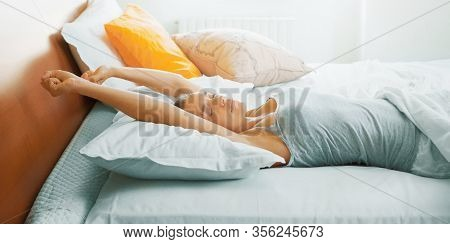 Young Beautiful, Woman Waking Up Fully Rested. Stretching