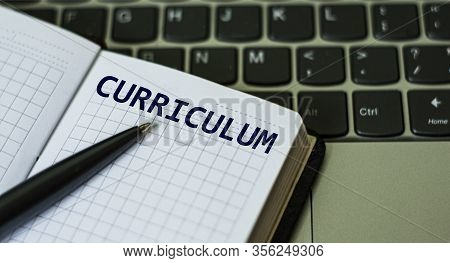Notebook With A Pen And The Word Curriculum , On The Background Of A Laptop