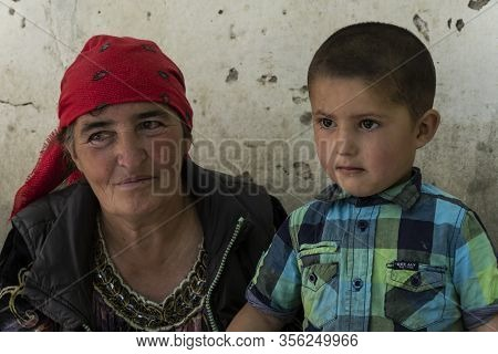 Yemtz, Tajikistan - June 17, 2020: Family With Mother And Child In The Bartang Vally At The Pamir Hi