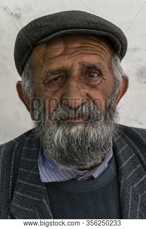 Bartang, Tajikistan - June 18, 2019: Portait Of An Old Man With Beard And Hat In The Bartang Valley