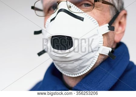 Senior Man Protected With Ffp3 Respirator. Coronavirus Protection Concept