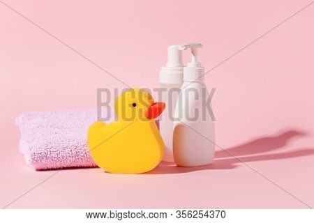 Spa And Bath Concept. Baby Bath Set. Cute Child Spa Composition In Yellow Pink Color. Soap Bottle, M