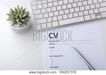 Curriculum Vitae With Pen On Whtie Desk