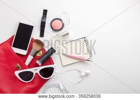 Red Woman Bag With Cosmetic, Sunglasses, Smartphone And Accessories
