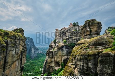Monastery of Varlaam in famous greek tourist destination Meteora in Greece on sunset with scenic scenery landscape